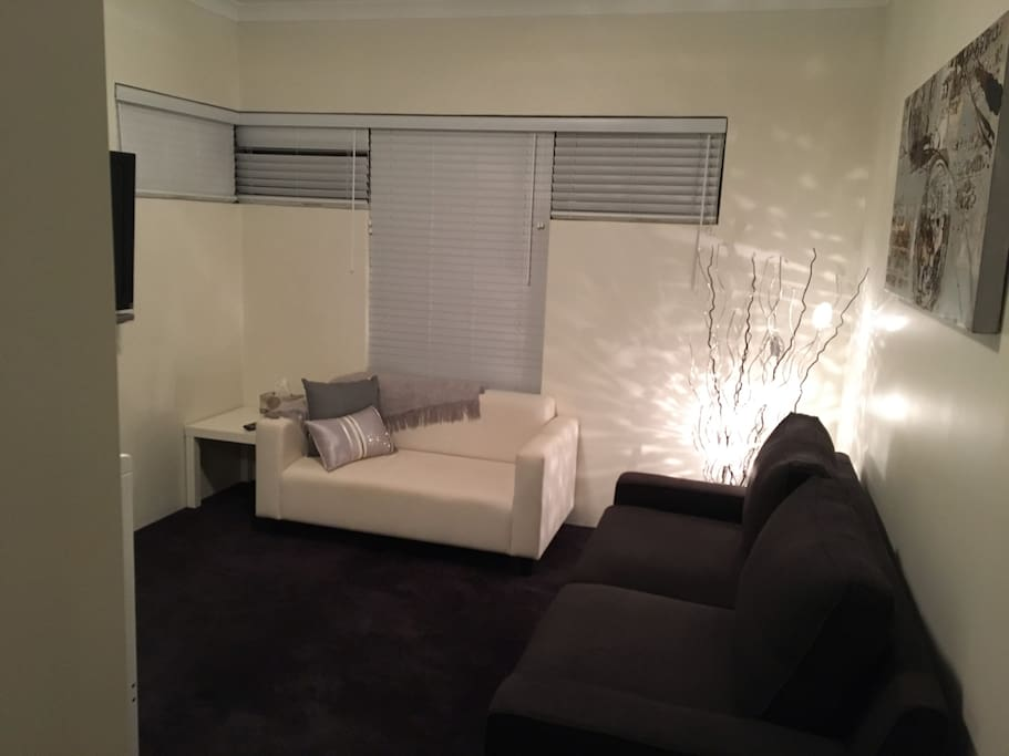 "Living room with wall mounted 42"" television"