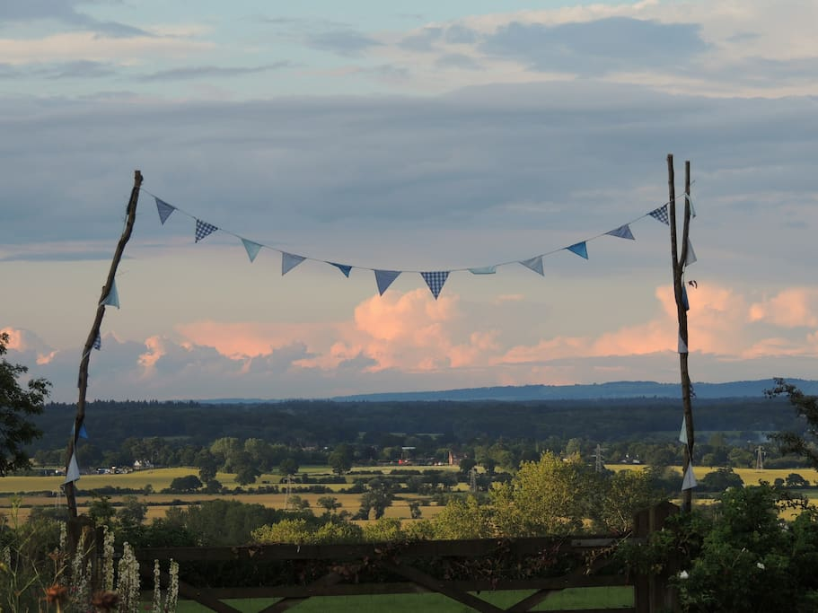 Wonderful views to the North Downs from the garden. We are on Stone Cliff which the sea originally reached so have far reaching views from an elevated position. Flags are left over from having a son's wedding in the garden!