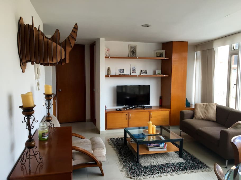 Enjoy our spacious living room with Cable TV, Apple TV, and Netflix.