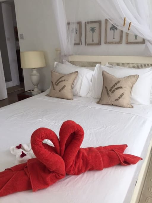 Romantic swans on the Queen sized bed! xoxo