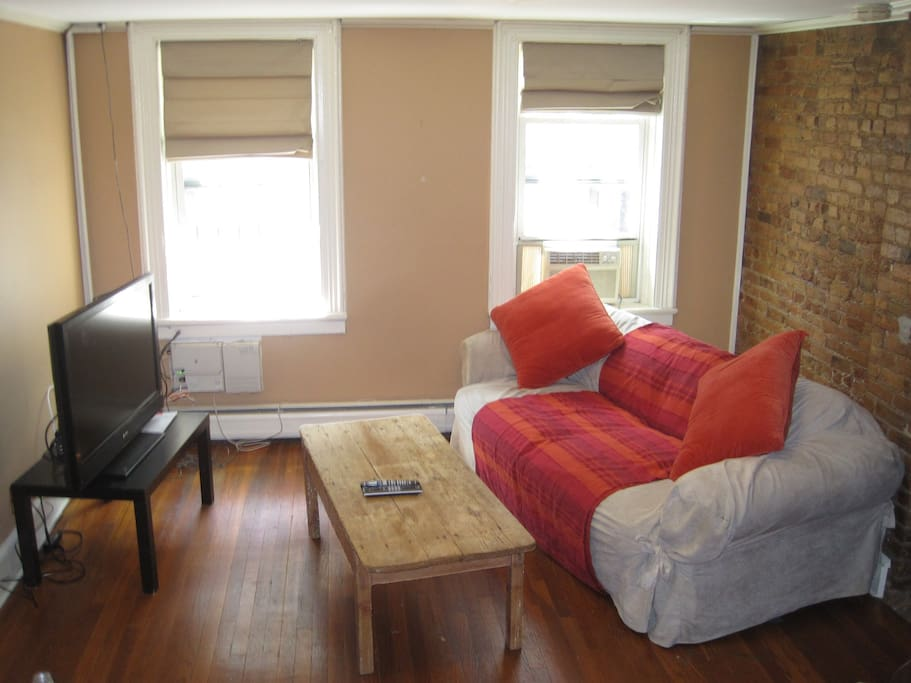 Relax in the living room with a large TV, lightning fast internet, cable, and comfortable couch.