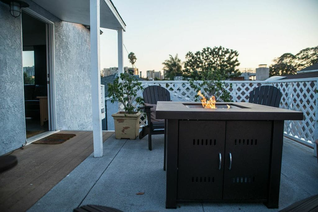 Outdoor gas fire pit on one of two west facing decks.
