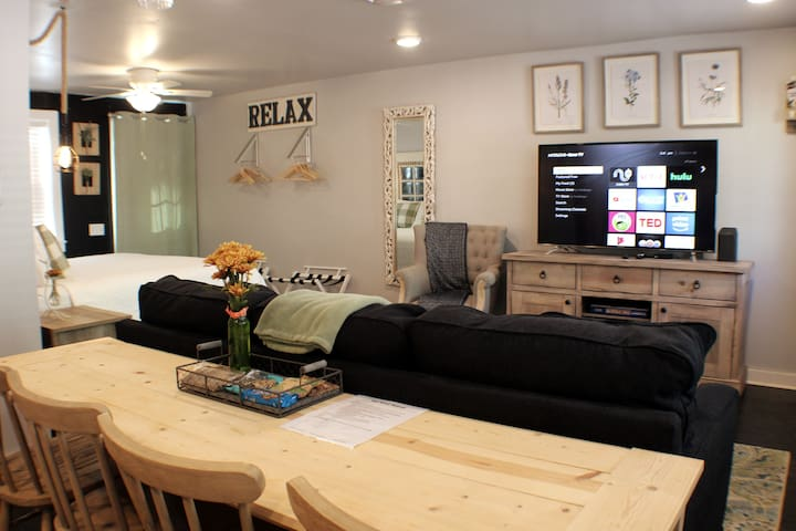 This studio is small but spacious.  Here's a look from the kitchen into the dining area, living room and bedroom.  The Smart TV offers access to cable TV, Netflix and Hulu.