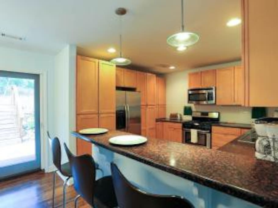 Spacious kitchen, with barstool dining plus separate dining table for total 6 guests.