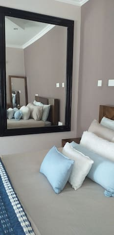 spacious bedrooms with wall size mirrors