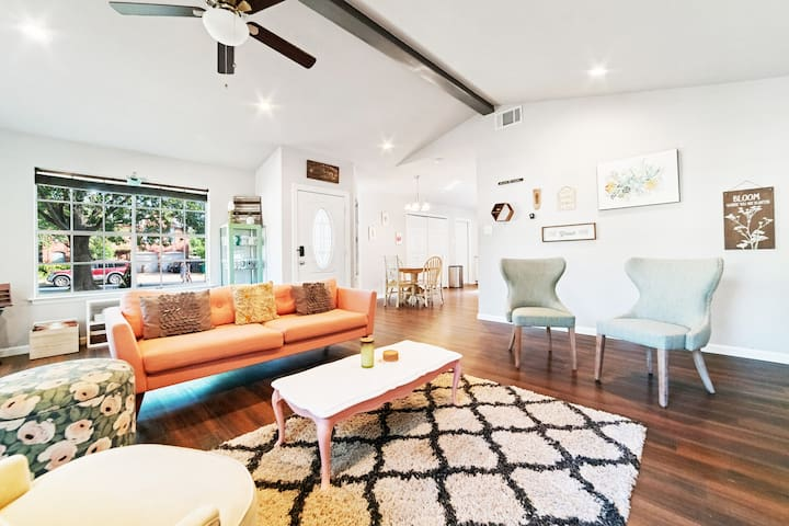 Living room with entry door.