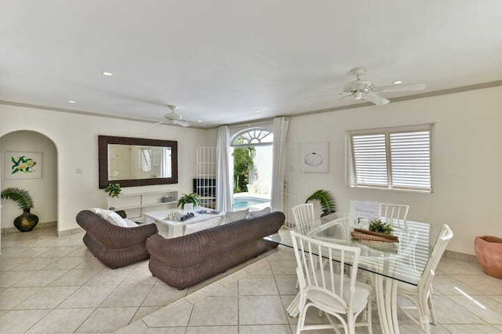 The open-concept living and dining room are ideal for families and walk out to the grill and pool area.