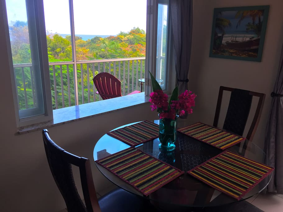Dining area with views across forest, to Aguadilla Bay.