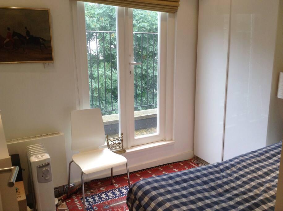 Guest bedroom facing gardens hence quiet.