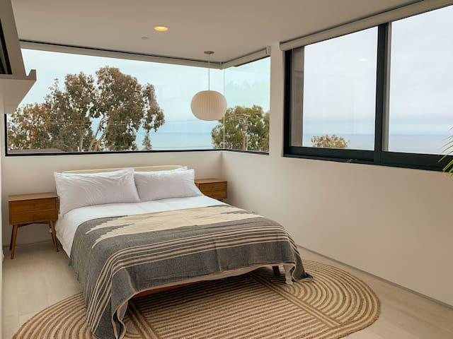 Bedroom #2: Queen bed, closet, ocean views, en-suite bathroom