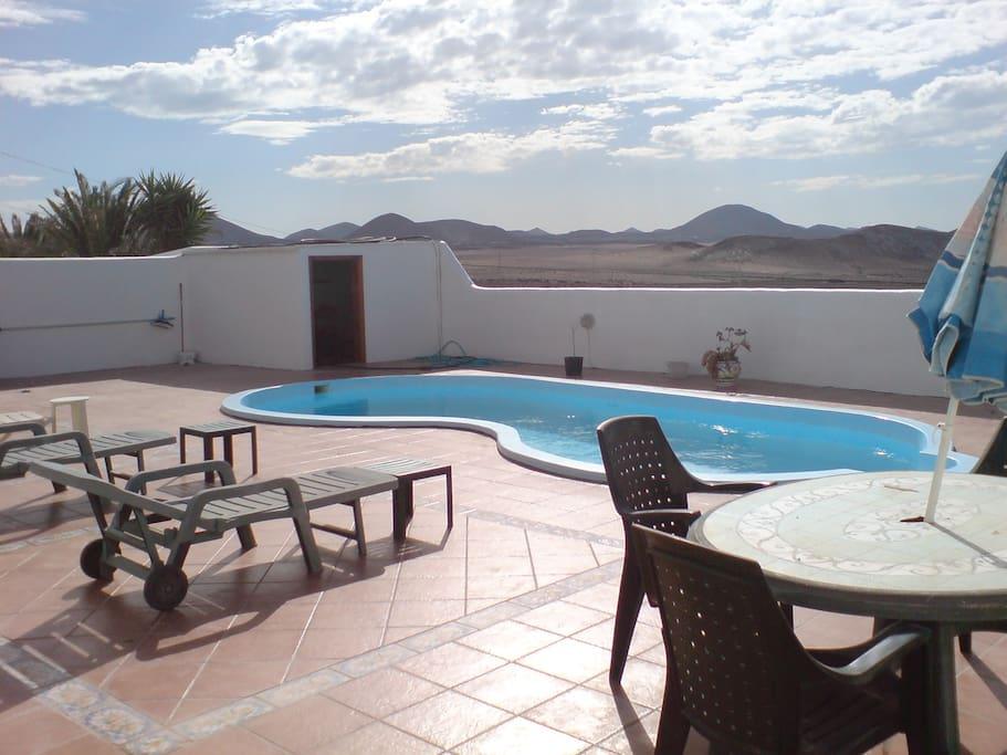 Large rear patio with great views of distant mountains