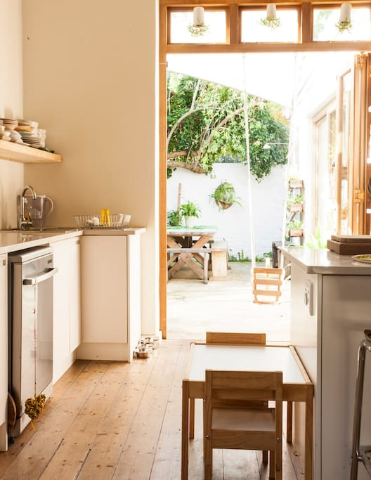 The kitchen leads out to the courtyard,  you can open up the space entirely to let the outside in. Also allows for a swing for the kids.