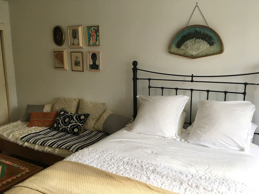 Queen size plush bed accommodates 2