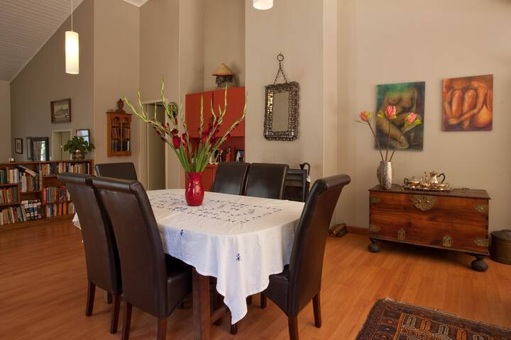 Open plan dining room with 6 seater dining room table