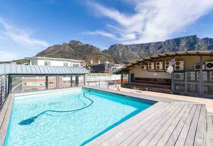 Pool access at Temple House with sweeping views of table mountain. Walking distance from our apartment:)