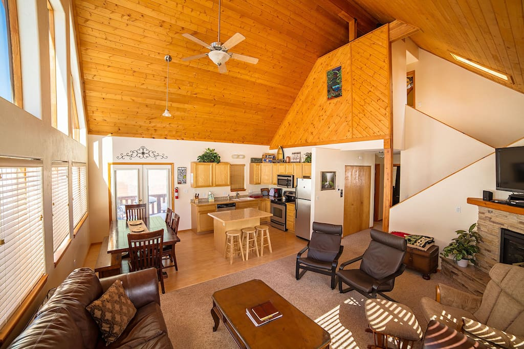 Vaulted ceilings and an open-floor plan make the home feel even more spacious!