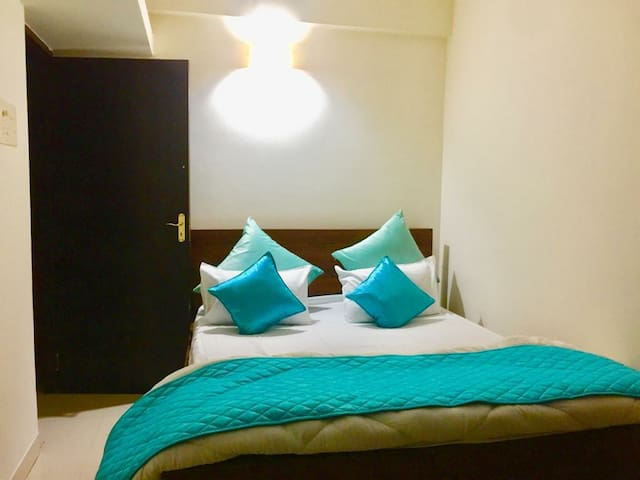 Second bedroom with a beautiful look to the private balcony looking at the mangrove forest and neru river . You can sit and see beautiful river view in the morning and lovely sunset