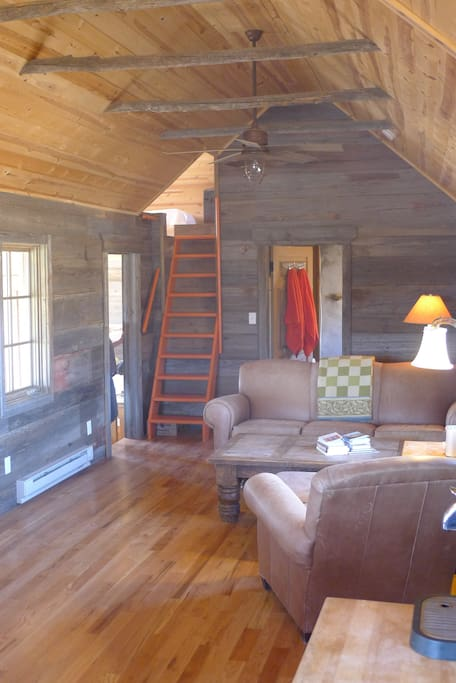 Living room with ladder to the sleeping loft