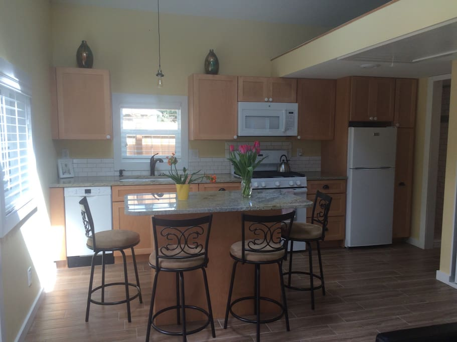 Beautiful new kitchen and island with granite countertops.