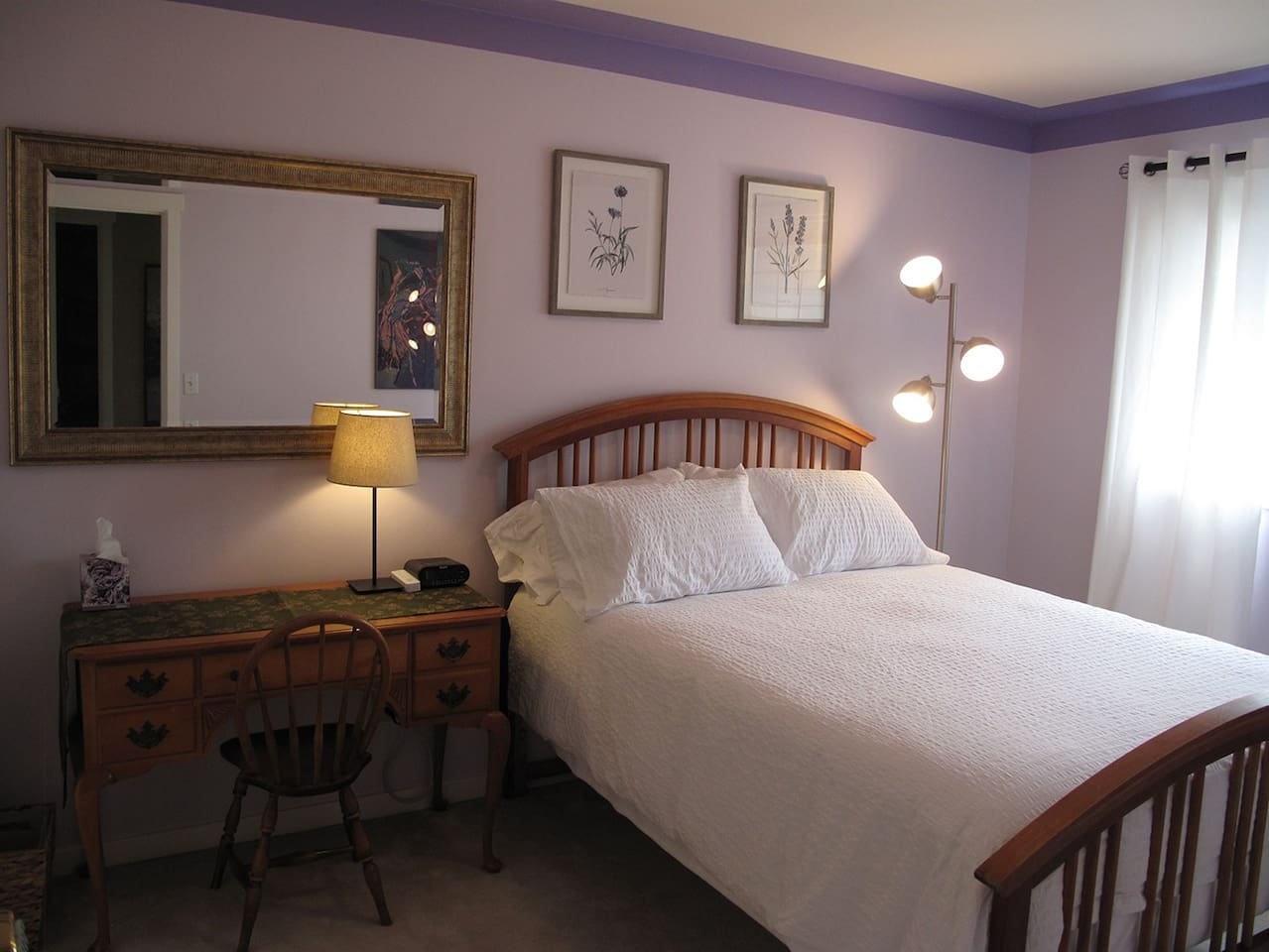 Bedroom has double bed and ample lighting