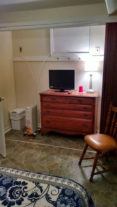Full bed with dresser and closet area in bedroom. Tv with remote and oil filled radiator heater if needed.