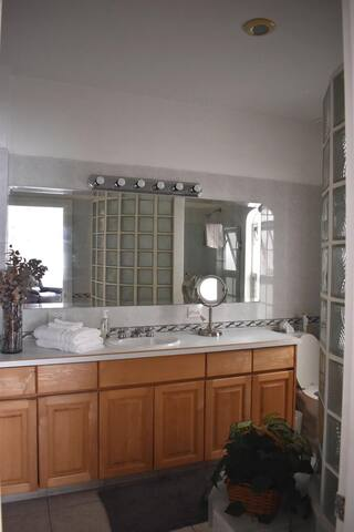 Beautiful spacious, tiled, private bathroom with a large shower.  Also lots of cupboards and drawers for your personal belongings.