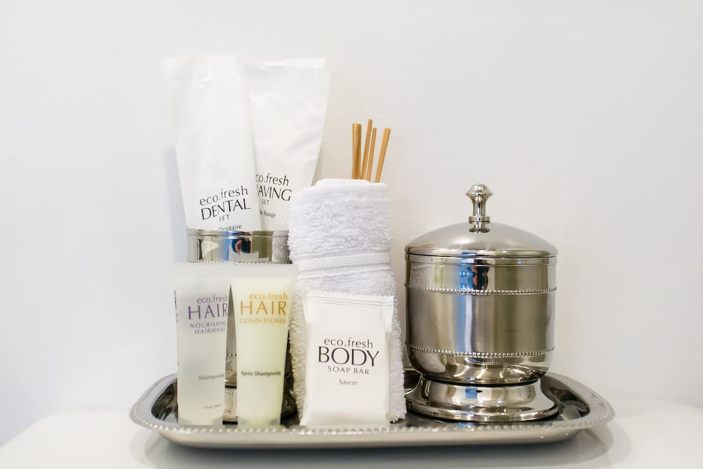 Bath amenities include dental kit, shampoo, conditioner, bath soap, cotton buds and cotton pads, face towel and bath towels
