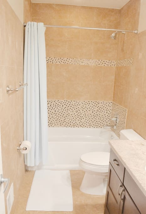 Guest bathroom: includes a tub and shower