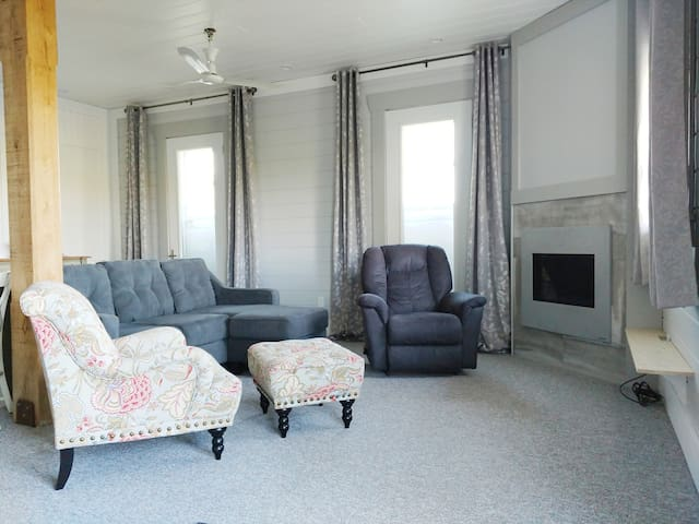 """Open Living Room area with Lazy Boy Recliner, Gas Fireplace and 50"""" Satellite TV"""