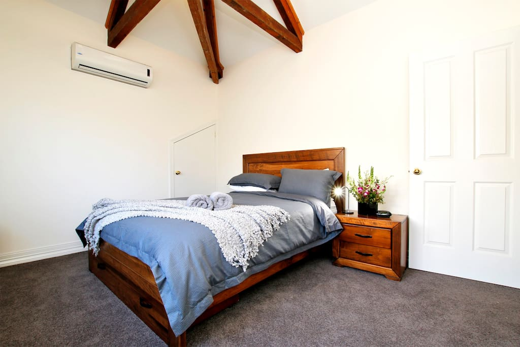 2nd Upstairs bedroom with exposed beams