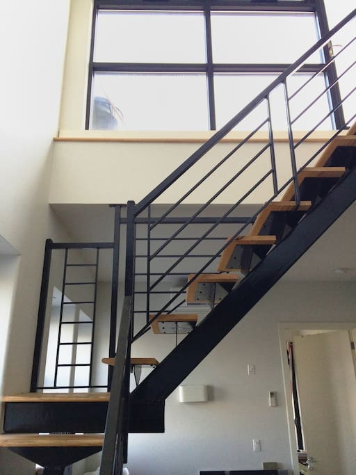 Staircase leading to the upstairs bedroom and deck