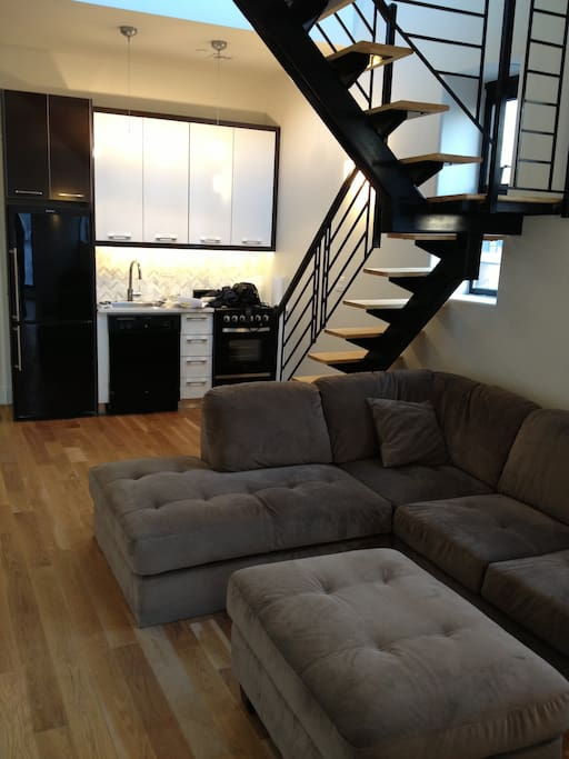 Lovely open kitchen and living room with comfy L-shaped couch