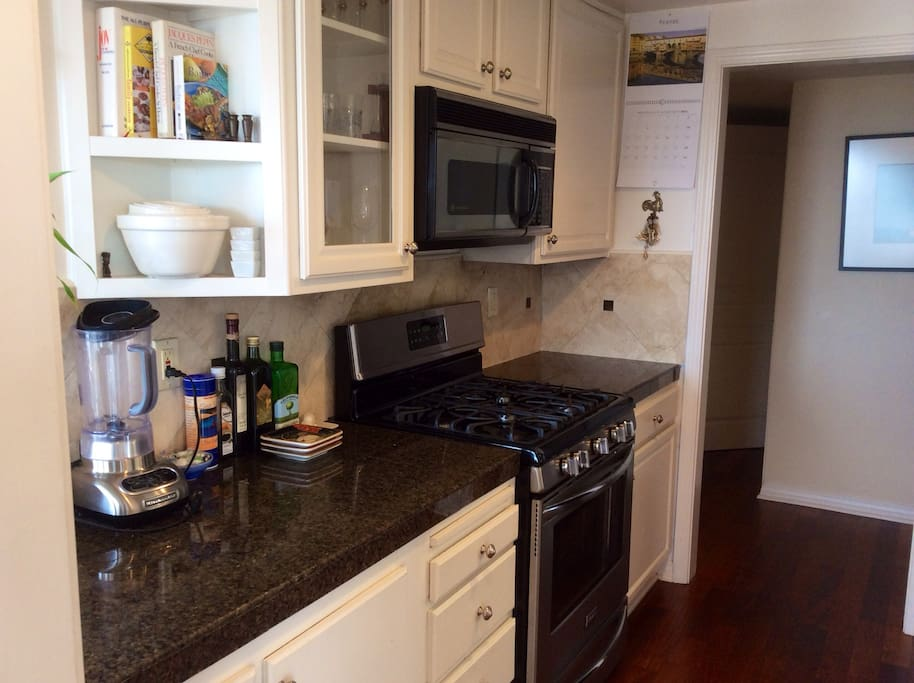 Kitchen with all the comforts of home, granite counters, stainless appliances, new gas stove with convection oven.