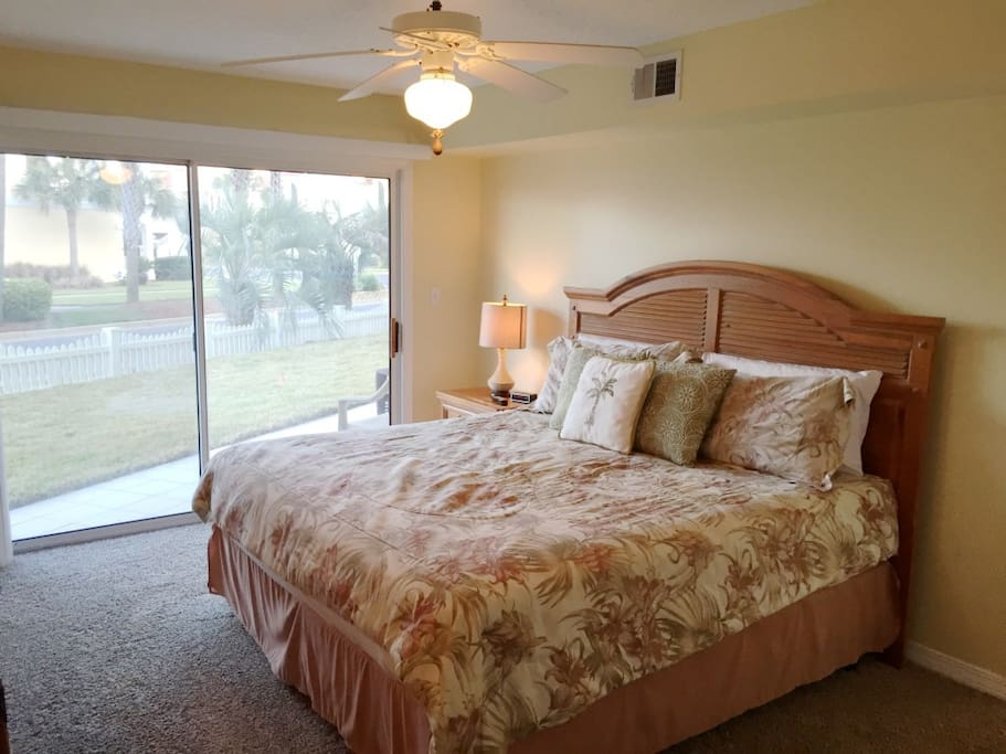 Sleep Late in the New Comfy Pillow Top King Bed. Walk out to the Patio.