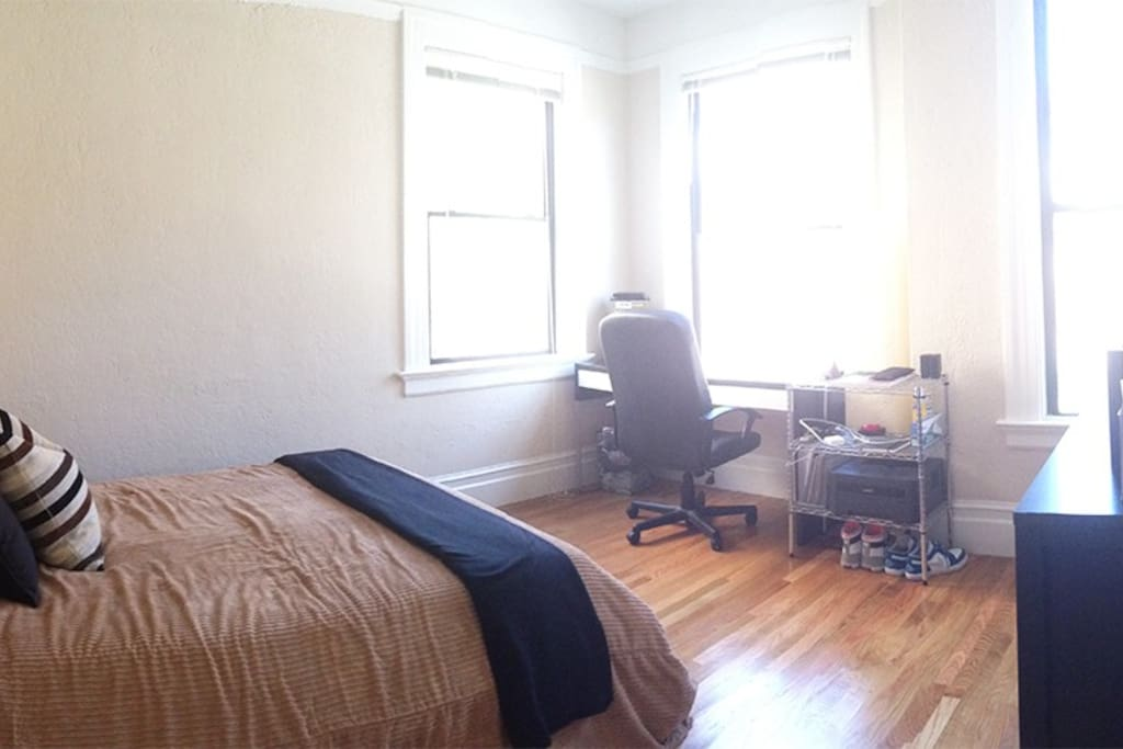 Here's the bedroom. Lots of natural light can come in through 3 huge windows, but you can also lower the blinds.