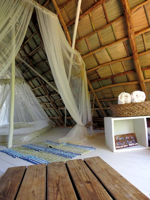 Mosquito nets are part of the cozy interior