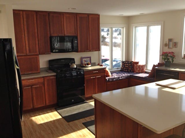 The kitchen with window-seat has gas stove w/ double-oven. You are welcome to bring food and cook during your visit.