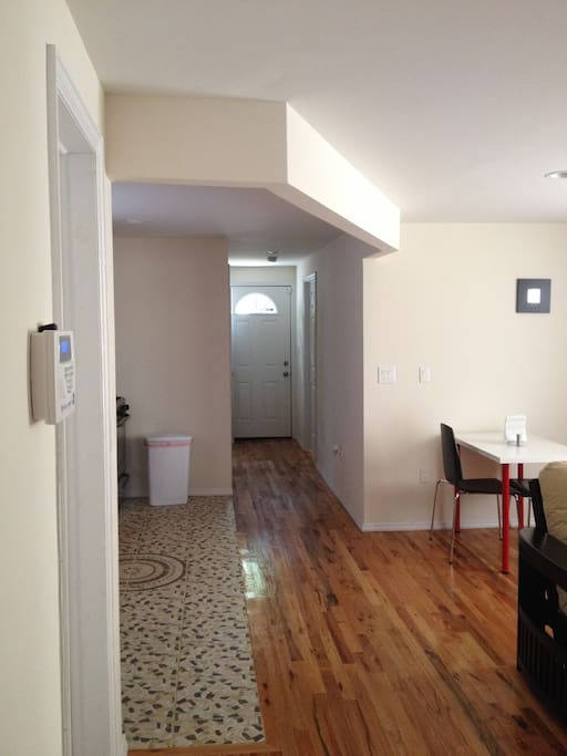 Entering Apt. #1 on the 1st floor (door to the back leads to backyard)