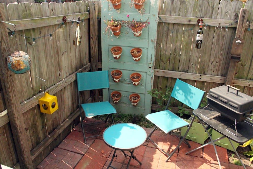 Backyard patio with grill & citronella lanterns.