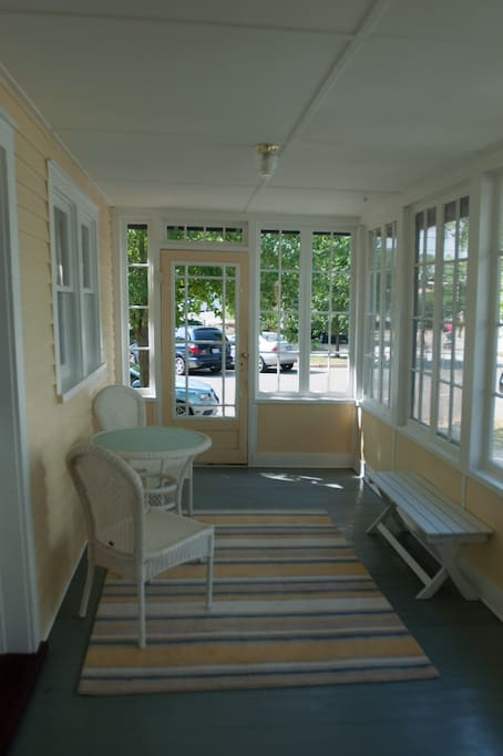 You'll enter Mariner's cottage from this enclosed front porch. Enjoy your morning coffee and people watching from this cheery space.