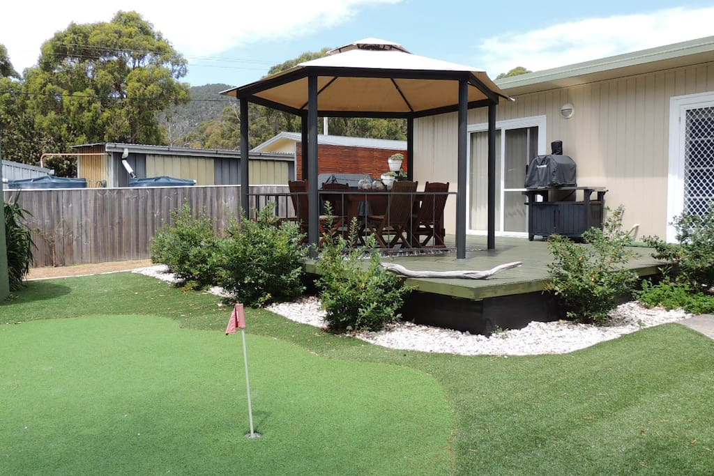Back of the cottage with putting green.