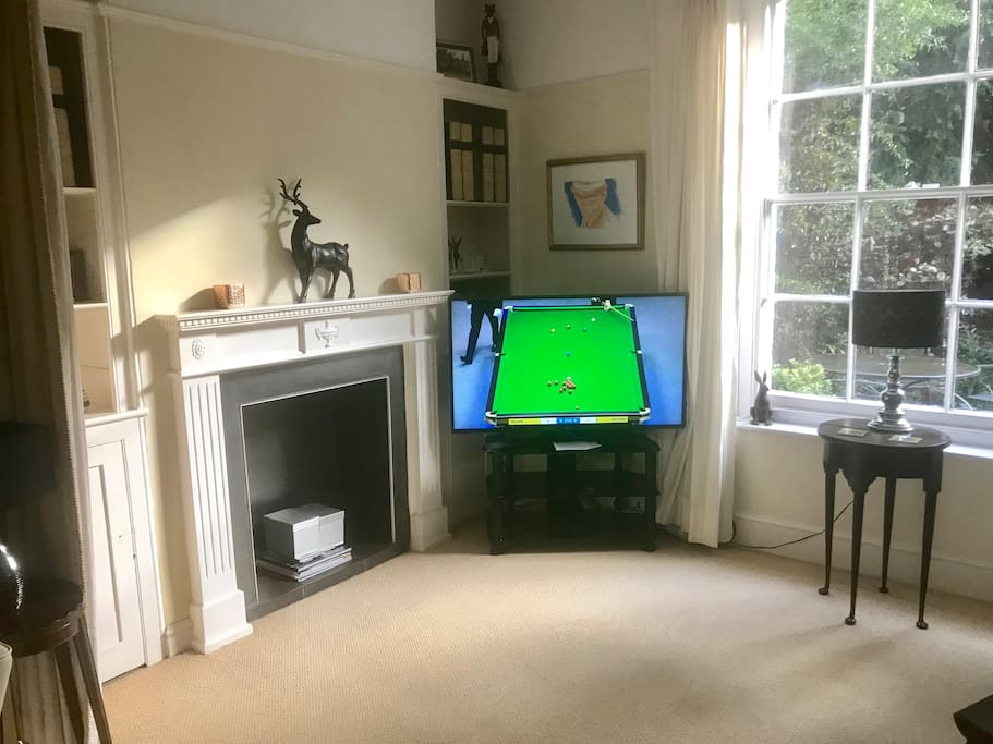 The living room with a 50 inch tv, smart tv with BT Sport and many HD channels