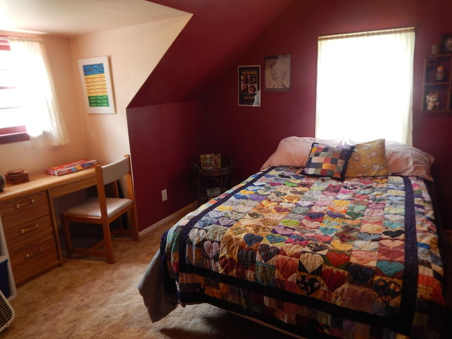 Comfy bed in private upstairs space - lots of pillows and handmade quilt