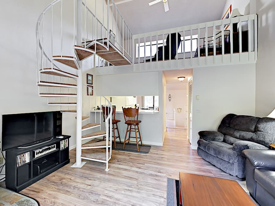 """The open living area includes a 40"""" flat screen TV and plenty of seating."""