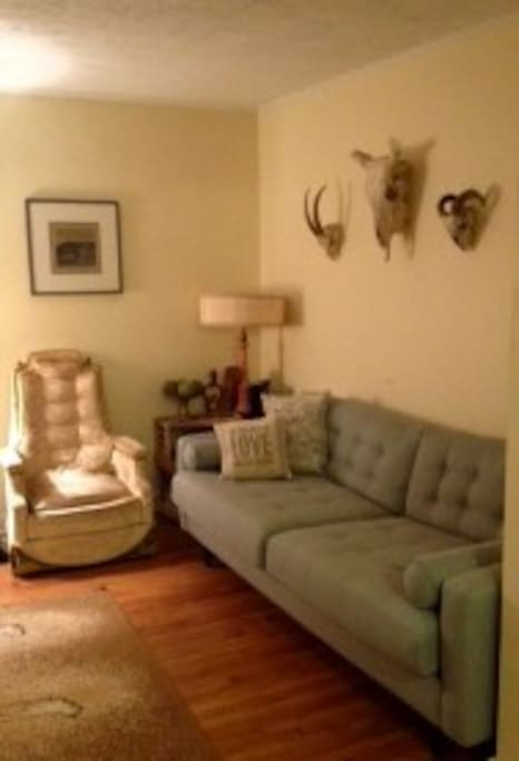 Brand new comfy 6 ft. long couch in the vintage and western inspired living room