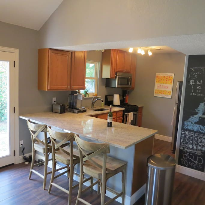 Kitchen with granite counter top and stainless appliances