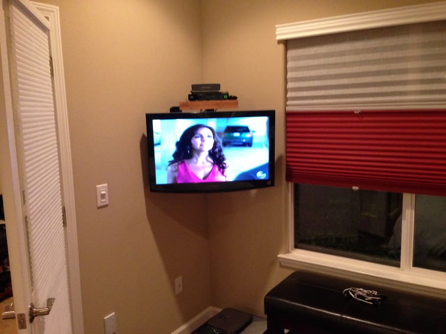 Flat screen TV and blackout shades.
