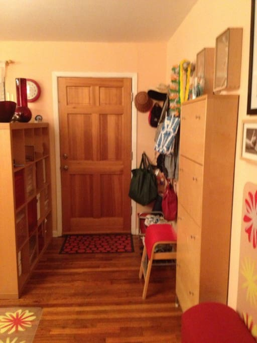 This is the entry way area with space for coats, bags, and shoes
