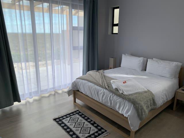 Bedroom 2 with sliding doors - view of wildlife, Dyer Island and fynbos
