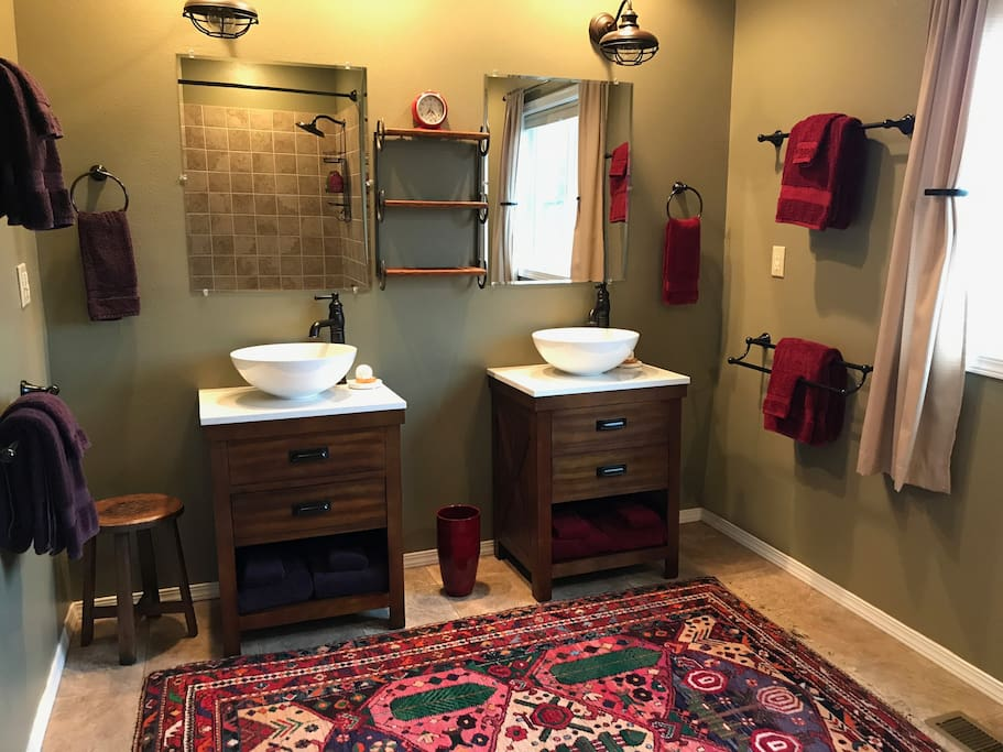 Double sinks in the guest bathroom with plush towels and robes, too! Hosts use separate facilities downstairs.